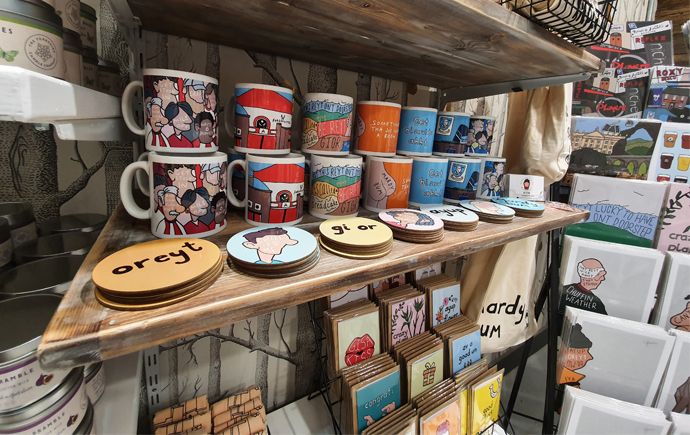 Cups and postcards for sale in the Independent Sheffield Store in Meadowhall