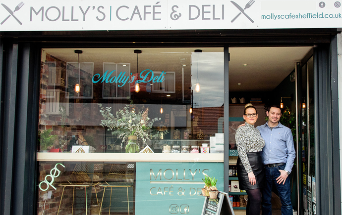 Lucy and Piotr Poplawski outside Molly Cafe & Deli