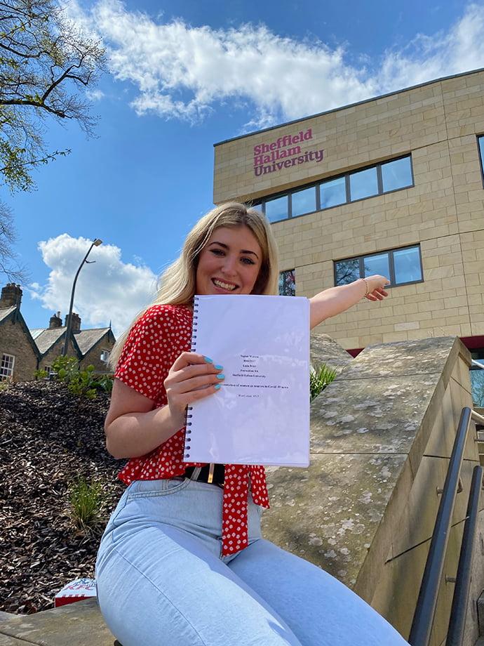 Sophie Watson handing in her dissertation